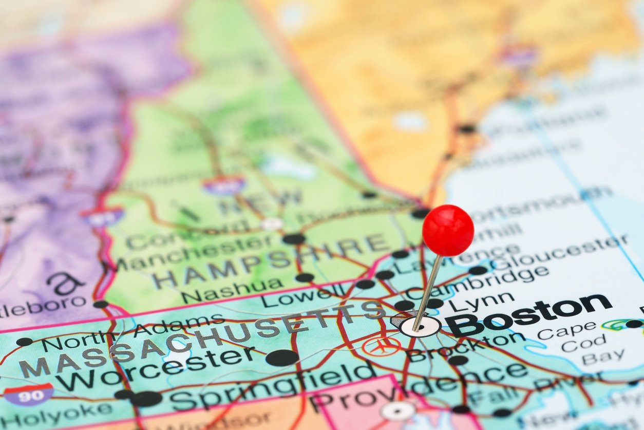 Photo of pinned Boston on a map of USA. May be used as illustration for travelling theme.